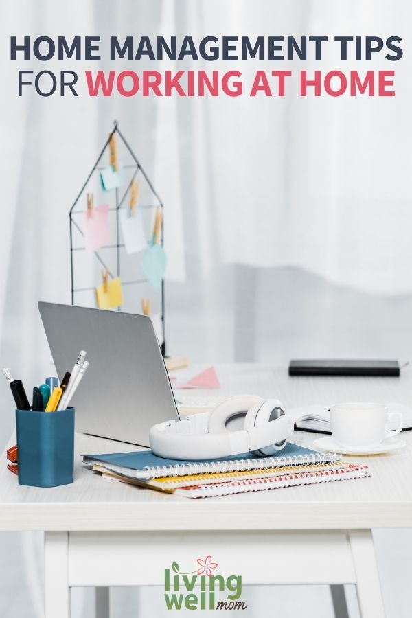 white home office desks with spiral notebooks, laptop and headphones