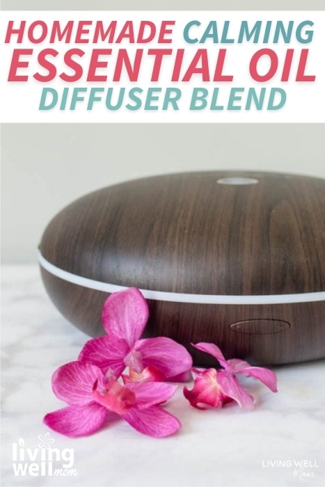 brown essential oil diffuser with orchids