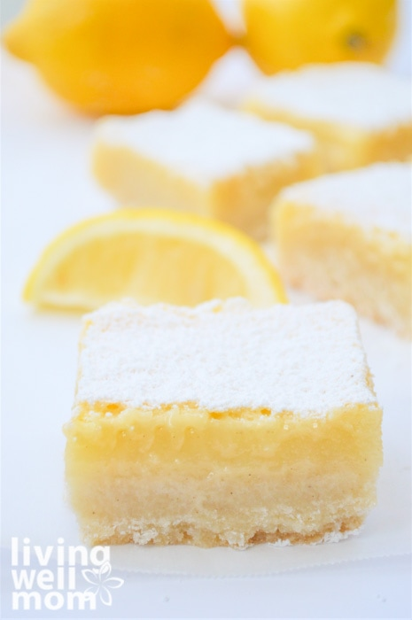Thick lemon bar with powdered sugar on top.