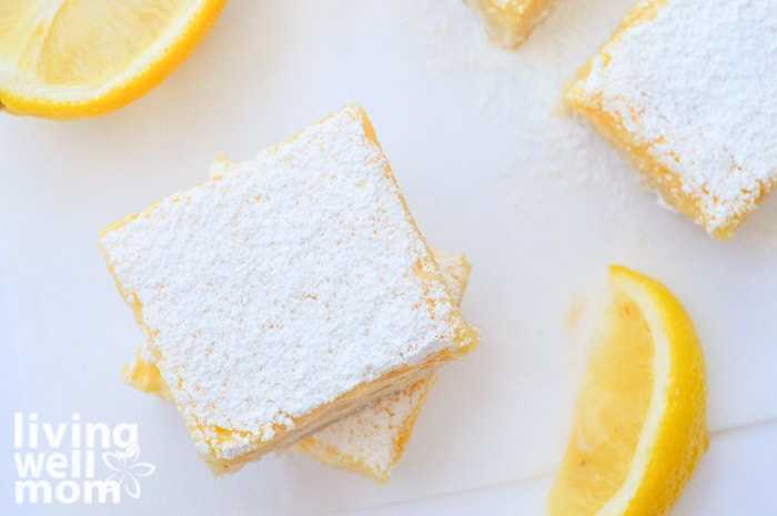 gluten-free lemon bars with slices of lemons