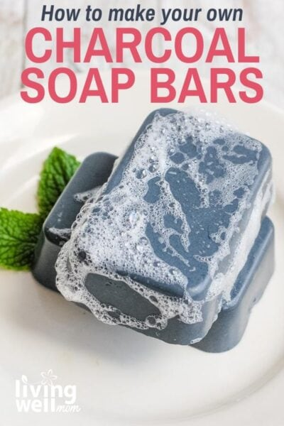 sudsy charcoal soap bars on a white plate with mint leaves