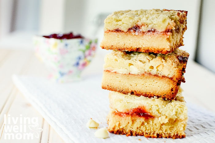 stack of raspberry bars made with white chocoalte