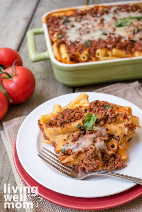 a plate of baked ziti with meat on a plate with a fork