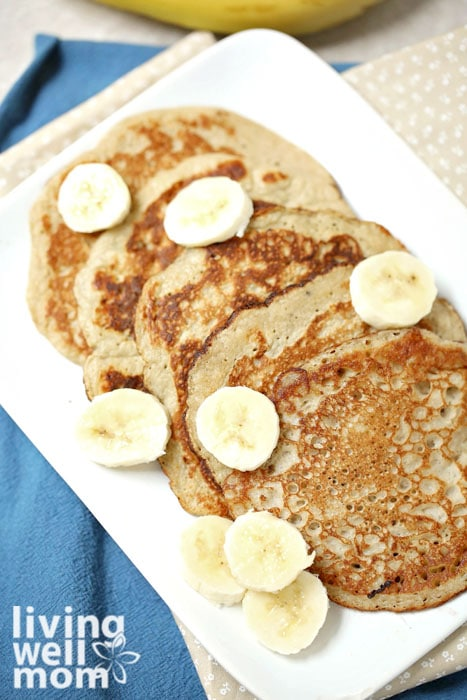 2 ingredient pancakes with sliced bananas on top