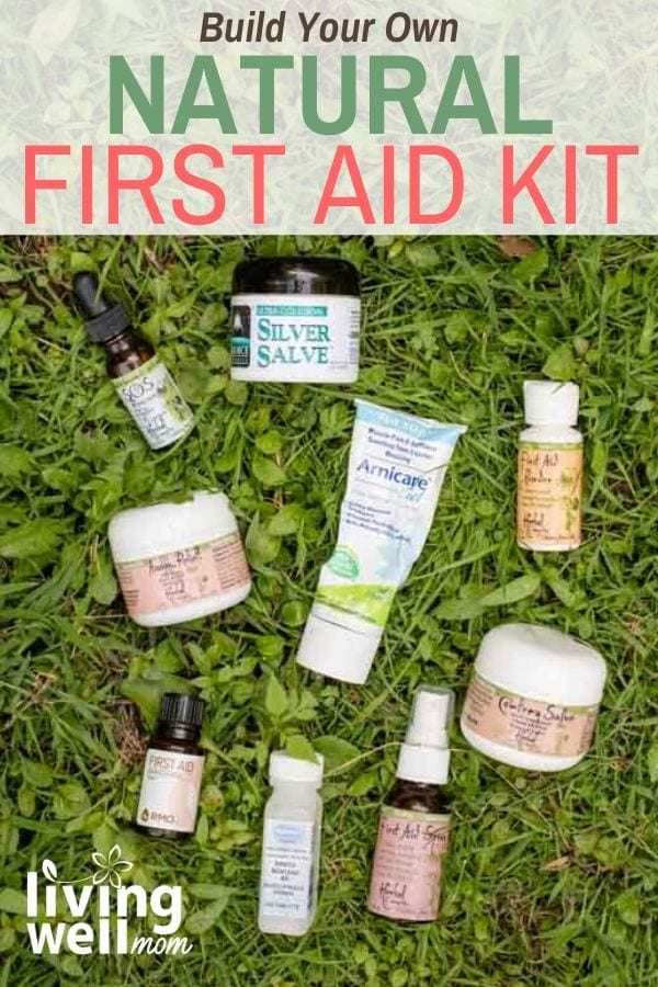 Natural remedies and first aid kit supplies lying on the grass