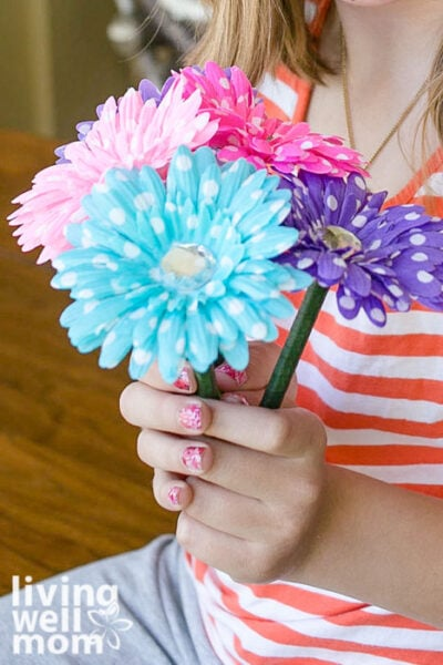 Girl holding a bouquet of colorful flower pens