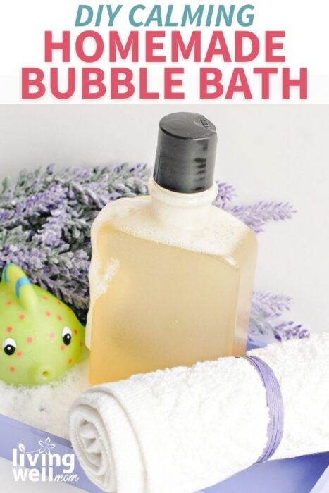 bottled homemade bubble bath on a lavender platter with bath toy and towel