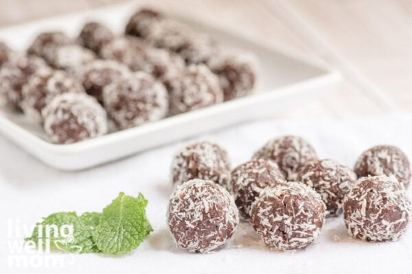 chocolate mint balls with coconut and fresh mint leaves