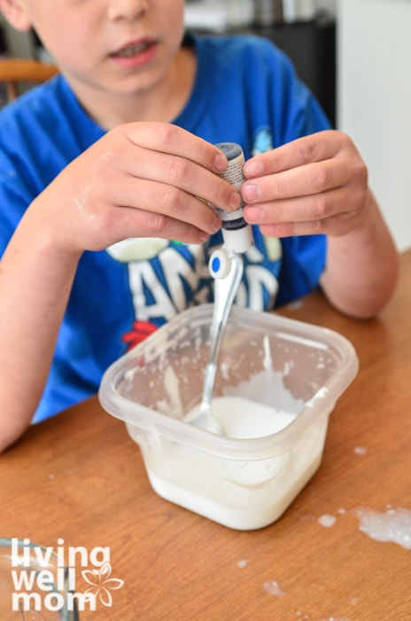 adding blue food coloring to glue mixture