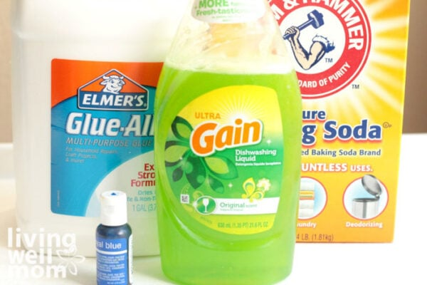 Supplies needed for slime without borax - glue, baking soda, gain dish soap, and food coloring.