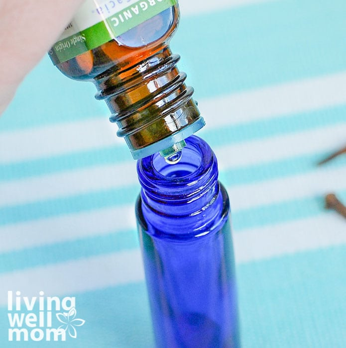 essential oil being added to a roller bottle