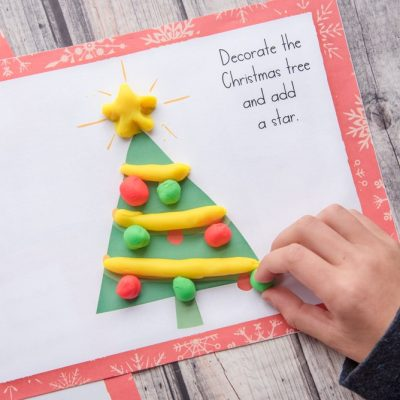 christmas tree play dough mat with colorful play doh child playing