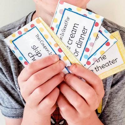 boy holding reading reward coupons