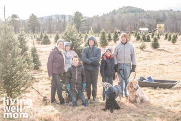 family at a christmas tree farm