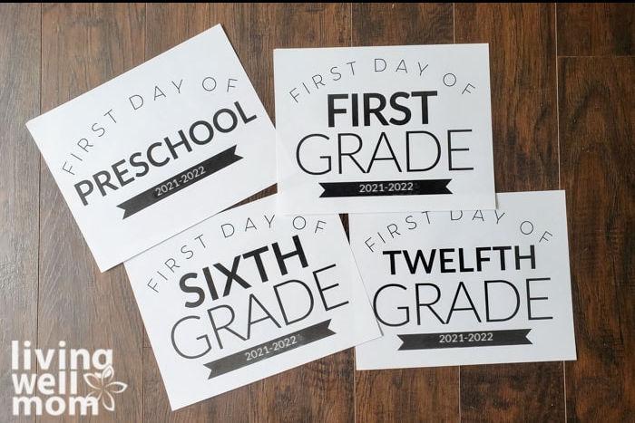 printed first day of school signs preschool-twelfth grade on dark wood