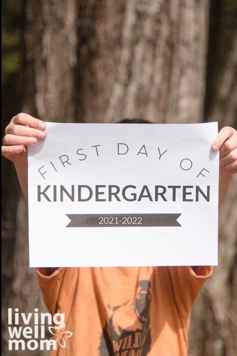 boy holding first day of kindergarten sign 2020-2021