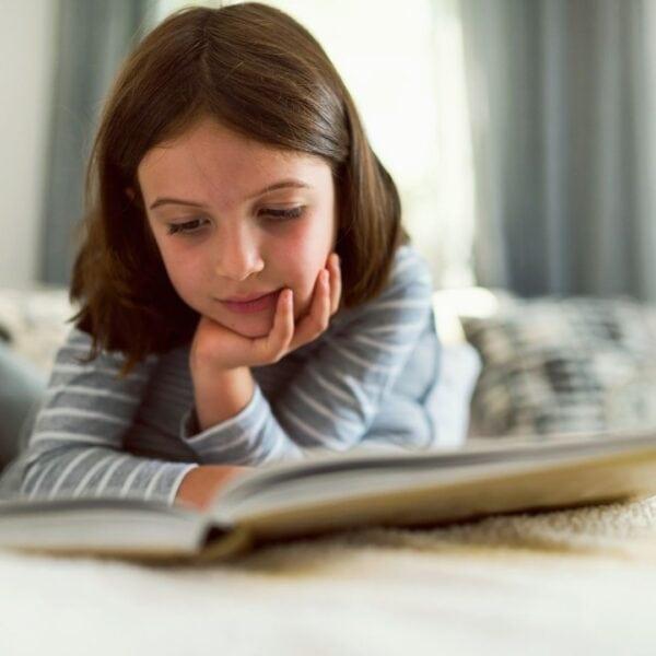 little girl enjoying reading