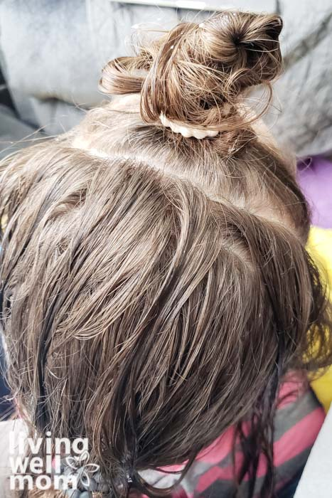 girls hair tied up for combing out lice