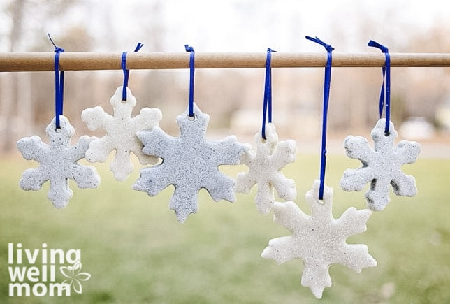 salt dough ornaments shaped like snowflakes hanging