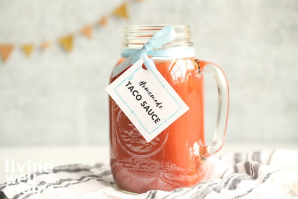 homemade taco sauce recipe made in a mason jar with a label