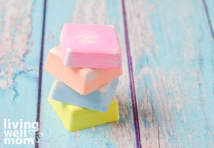 Colorful squares of DIY sidewalk chalk on a wooden surface.