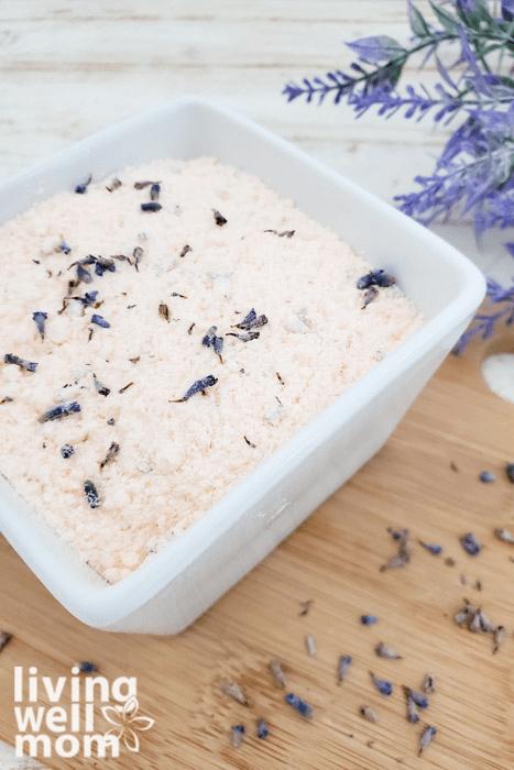 Glass dish of homemade bath salt with epsom salt.