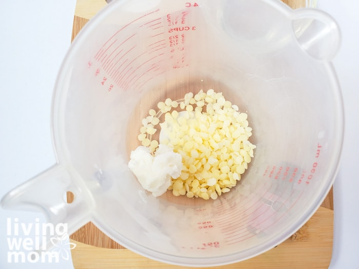 Beeswax and shea butter in a measuring cup to be melted together.
