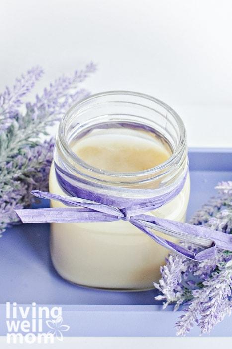 Mason jar with DIY foot balm nestled in lavender