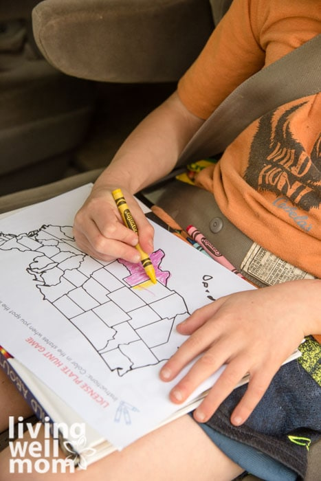 Kid learning geography by coloring states in a license plate game