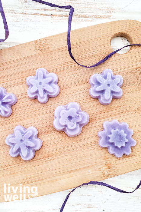 Six shea butter lotion bars in flower shapes, made from a DIY recipe.