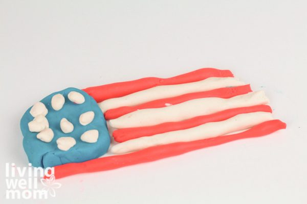 American flag made out of playdough on a white background.