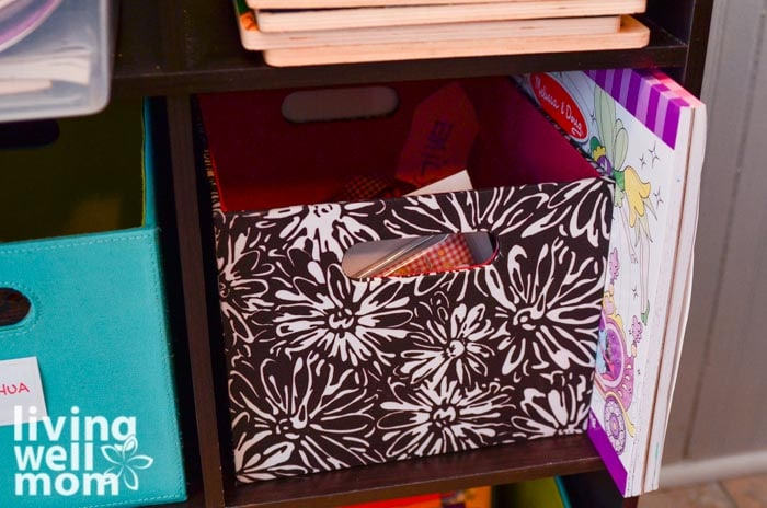 organizational cubbies to store kids games and supplies