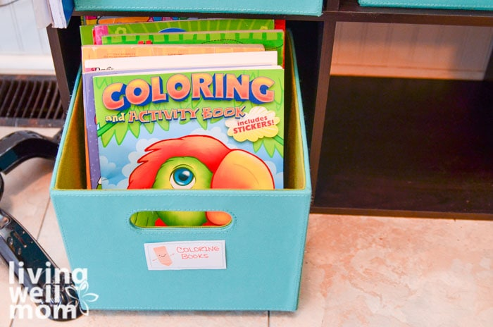 storing kids coloring books in a blue cube