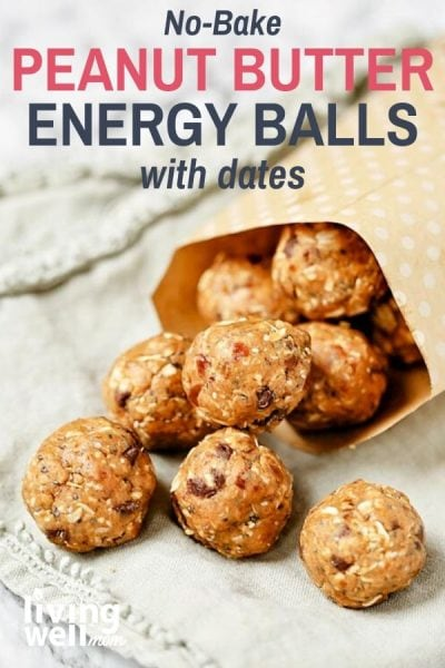peanut butter date energy balls in a paper bag on light green napkin