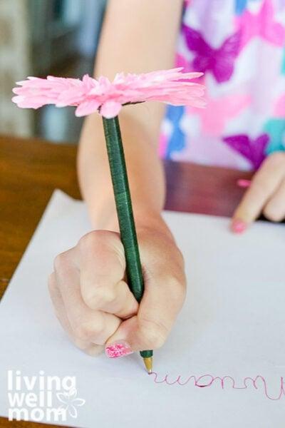 Girl holding a DIY flower pen