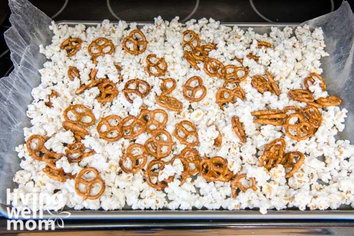Pretzels over popcorn on baking sheet