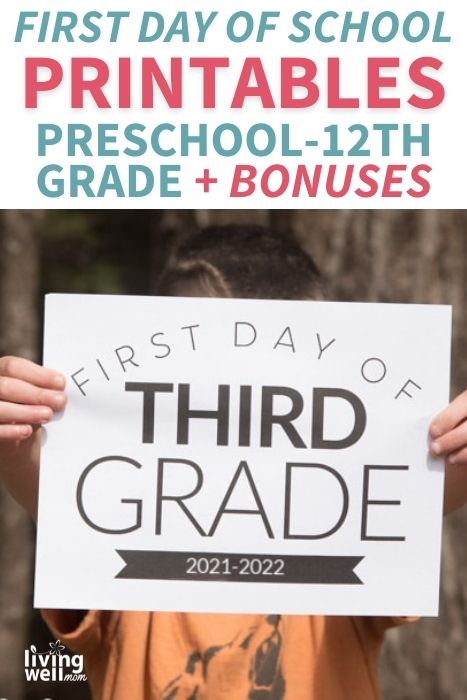 boy holding first day of third grade printed sign 2021-2022