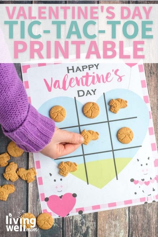 Child playing a tic tack toe valentine game