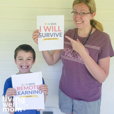 mother son holding remote learning and i will survive signs laughing