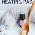 gray sock with lavender essential oil and rice on brown spoon - diy heating pad