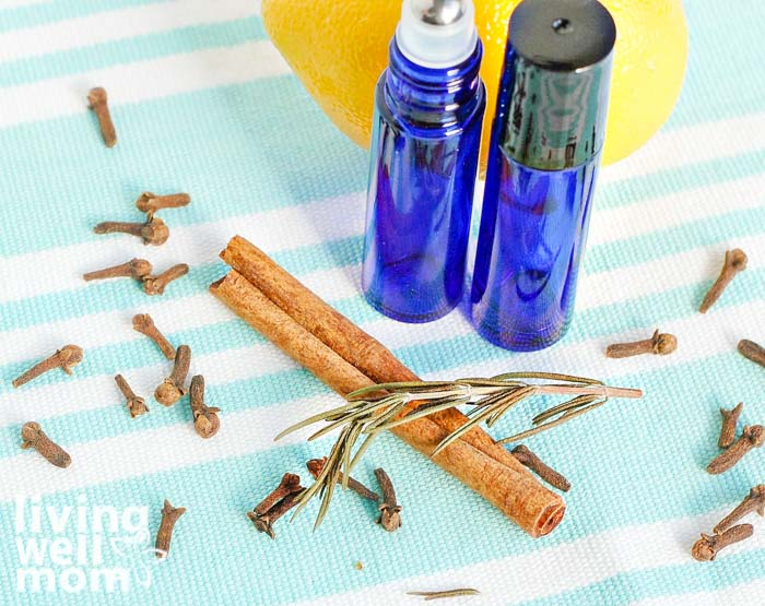 essential oil rollers with cinnamon stick