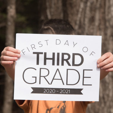 Child holding a first day of third grade sign