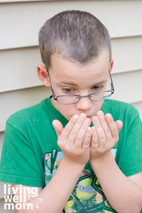Boy smelling essential oils on hand