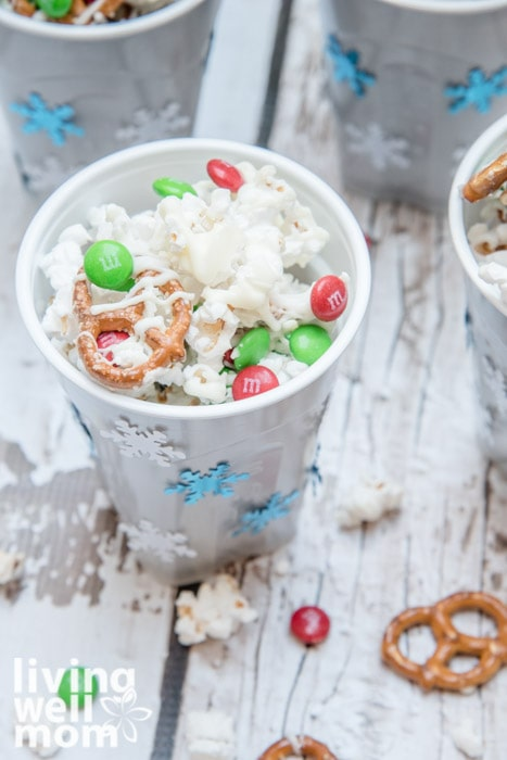 solo cup decorated with stickers and white chocolate popcorn inside the cup