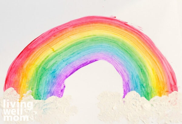 Finished kids art piece of a rainbow with clouds