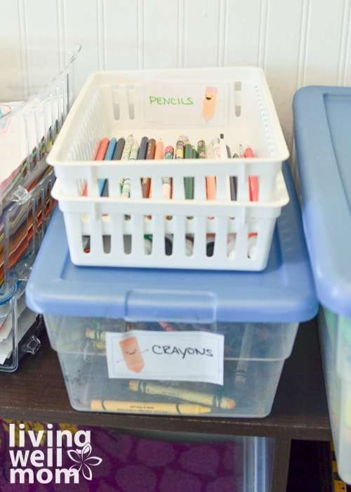 bins filled with crayons and pencils