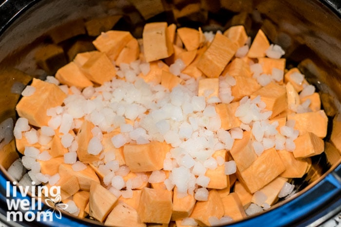 chopped sweet potatoes and onions in a slow cooker
