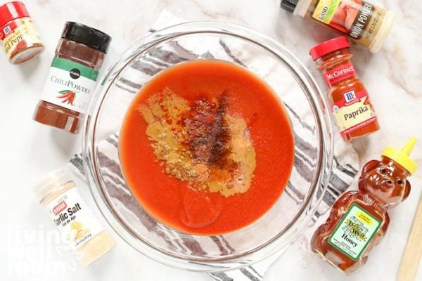 homemade taco sauce recipe with spices surrounding the bowl