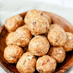 Close up of a bowl of energy balls with peanut butter